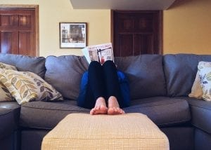 woman relaxing in a clean home