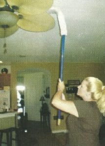 christine cleaning an overhead fan